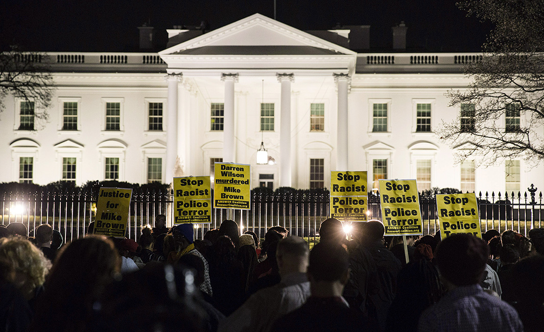 Protesters demonstrate after the decision by a Missouri grand jury not to indict a white Ferguson police officer in the fatal shooting of unarmed black teenager Brown, in front of the White House in Washington